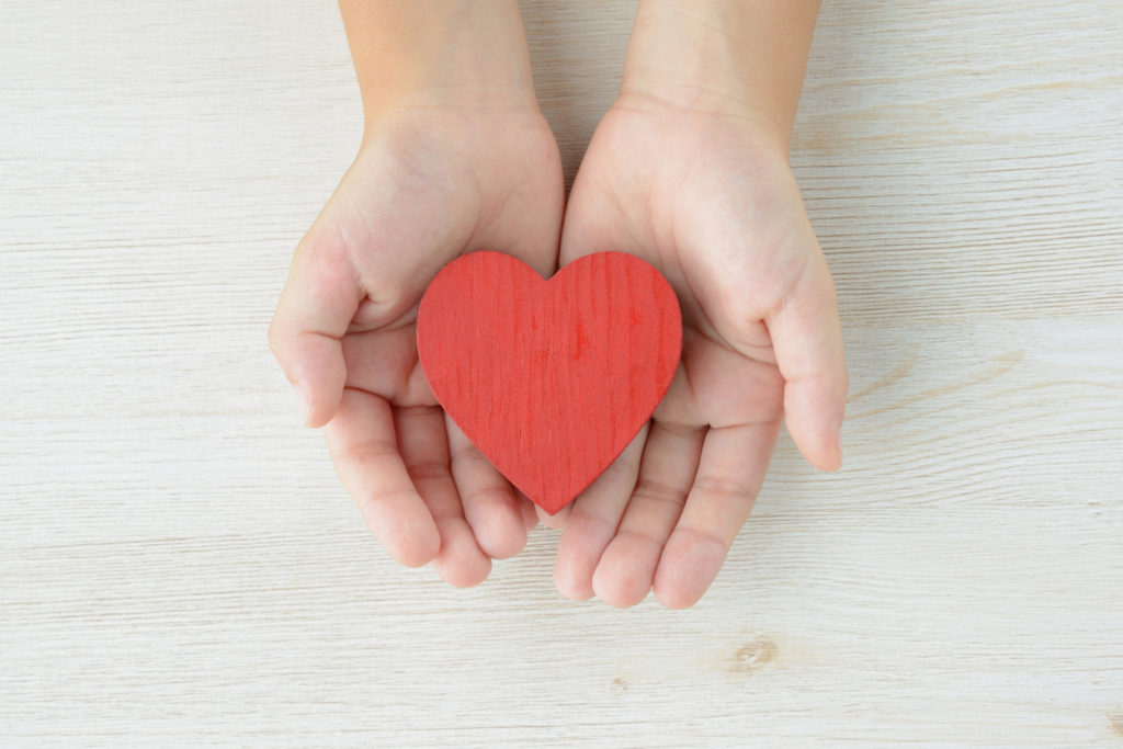 Heart object covered by child's hands